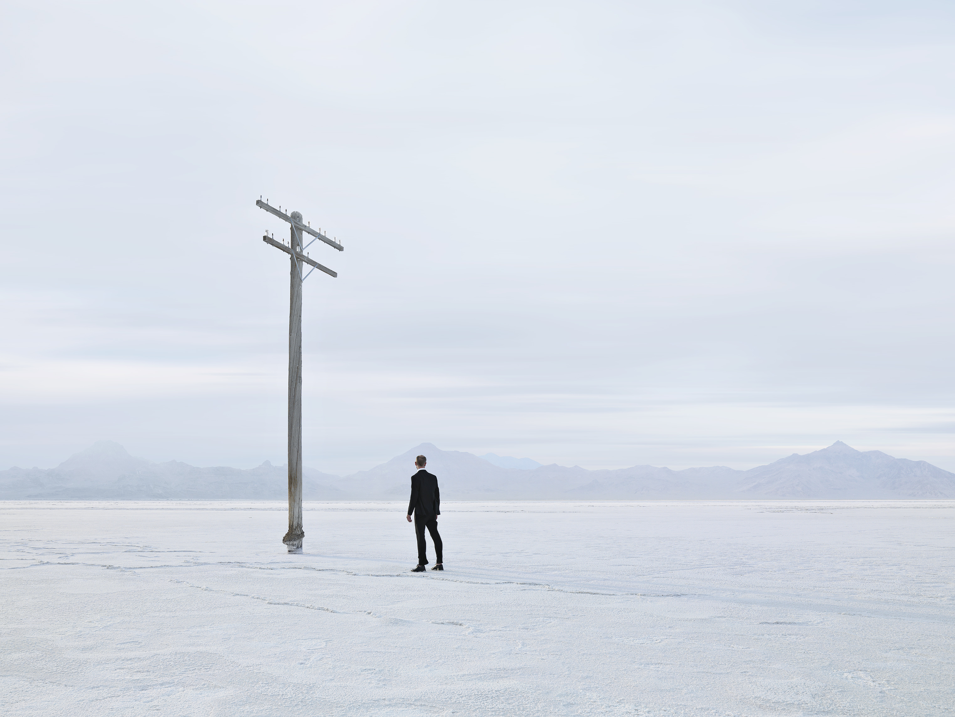 Man and Pole in Salt Flats